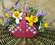A BASKET OF SPRING PAPER FLOWERS