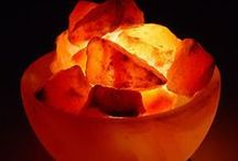 Natural Himilayan Salt Lamps /  The air we breath consists of ions (atoms or groups of atoms) that carry either a positive or a negative electrical charge. Computers, TV sets, air conditioners, tobacco smoke and many other by- products of modern living produce positively ionsed air, which is detrimental to our health. Negatively ionsed air is generated by environments such as mountains, the seaside and waterfalls, and by means such as thunderstorms, gentle heat and Salt Crystal Lamps.