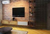 Дизайн-проект #ЖК_Дубль_в_лофте (60 кв.м) / Лофт получился достаточно брутальный, с красной кирпичной стеной, металлическим стеллажом на заказ. Кожаный стеганый диван отлично смотрится с состаренным журнальным столиком. В кухне отказались о большого количества навесных шкафов в пользу открытого пространства. Отделка стен серой декоративной штукатуркой под бетон выглядит актуально и отнюдь не мрачно, чего мы собственного и добивались! Сайт: http://саратов-дизайн.рф Группа: http://vk.com/designsaratov Телефон: 89271332827