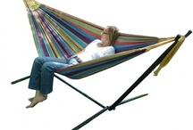 Hammock on a stand / With Spring and Summer on the way a hammock with a stand will make your garden so much more luxurious and relaxing.  Double matrimonial hammocks on a stand mean that two adults can snooze, doze and cuddle their way through the nice weather.  No need for two perfectly placed trees and so much more comfy. Move them with the sun or shade. They are also weatherproofed, and easy to assemble and have travel bags so you can even do a bit of glamping (glamorous camping).
