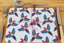 Majestic Macaw / Who's a pretty boy then? Our Majestic Macaw is!  Core look at our Macaw all majestic in flight on our designs! With the bold colour palette of deep reds, brilliant blues and a hint of green, this parrot is bound to turn heads!  #parrot #macaw #design #marthaandhepsie #lampshade #notebook #tropical #summer #homeware