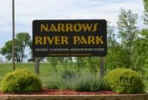 Narrows River Park / Narrows River Park provides boat access to the mighty Missouri River, just off I-29 in Council Bluffs. A covered shelter overlooking the river invites visitors to stay and enjoy the beauty of the river and the Omaha skyline downstream. In addition to the boat ramp, the 36 acre park includes hiking trails, horseshoe pits, archery range, equal access picnic table with checkerboard, playground and restroom.