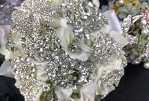 Bridal Bouquets and other designs some with jewels / Jewels add a special touch to any bridal bouquets, corsages or any flowers for a wedding or event.  These are just a small example of the designs we can do.  Enjoy!