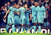 Man City Champions! /  Blue moon you saw me standing alone without a dream in my heart without a love of my own...  / by Kuzzie