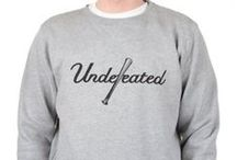 Undefeated / Undefeated Clothing was established as a top tier sneaker store in LA, USA in 2002. Eddie Cruz and James Bond were both joint business partners. Its name is unique from rest of the brands, undefeated stands for clothing, apparels, caps, accessories and shoe that have no match anywhere in style, comfort, creativity and designs. Its slogan is victory, virtue and honesty that rightly goes with brand name.