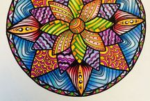 Samdala / These mandalas and other designs have been hand-drawn and are hand-coloured using pencil crayons and felt tip pens. This is a collection of my original work.