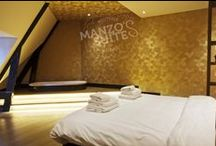 GOLDEN ROOMS - Manzo's Suites / Our glimmering gold colour suites. All our suites are equipped with an oversized smart TV, excellent Wi-Fi, a large luxury bathroom with rainfall shower, air conditioning and a king-size bed with crisp 100% cotton linen with a 300 thread-count.