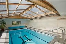 Swimming pools / A house with a swimming pool either inside or outside.