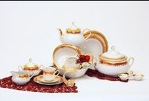 HOME: Thun Porcelain - Bohemian Garnet China Service / When I went to visit Prague in 1986 I immediately fell in love with the beautiful combination of porcelain, gold and garnet that I saw all around me in the form of fine China.  For a long time, porcelain existed as nothing more than a rumor in Europe, one that stemmed from Marco Polo's journal entries about the wonderful ceramic products from China. He named this mysterious material porcellana after the Italian name for the cowries, the shiny yellowish-white shell of which it reminded him.