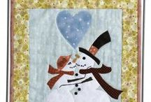 Winter Applique Designs / Small quilted wall hanging patterns for winter, including snowmen, sleds, snowflakes, cardinals.  All designs feature applique work and are easy patterns for beginner quilters.