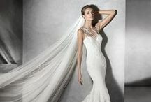 Pronovias / Designer based in Barcelona, Spain. Known for exquisite lace, embroidery, and high-quality silk fabrics.