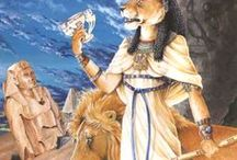 """Goddesses - Sekhmet / -Mythology: Egyptian /Other names: Sakhmet, Seckhet,""""The Powerful One"""". Nesert, """"the flame"""" / -Solar goddess of war and healing, depicted as a lioness or lion-headed woman with a Sun disc on her head. Protects pharaohs and leads them in warfare. Alongside a fearsome warlike side, there's also a protective and healing side, as protector of her allies and Ma'at, and patron of physicians. Associated as a Solar goddess with Hathor and Bast, and also with Wadjet and Tefnut"""