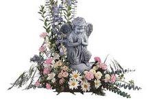Smuteční aranžmá a sochy hřbitovní