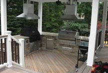 Installation of an Outdoor Kitchen / Installation of an outdoor kitchen complete with the plug and corded grills, ceiling paddle fans, state of the art vent hoods, recessed high hat lighting, in the steps lighting, and refrigerator locally in Bergen County New Jersey.