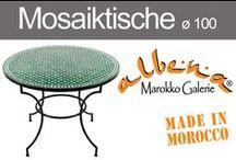 Mosaiktische ø 100cm / Marokkanische Mosaik - Esstische für 2 – 4 Personen. An diesen großen Mosaiktischen können vier Personen gemütlich sitzen und Essen.Die Mosaikplatten der marokkanischen Tische liegen lose auf den handgeschmiedeten Tischgestellen. In dieser Tischgröße bieten wir zwei verschiedene Untergestelle an. Wählen Sie ganz nach Ihrem Geschmack und erleben Sie selbst, die Einzigartigkeit eines marokkanischen Mosaiktisches.