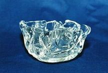 Usable glass - Sugar bowls, candlesticks and others / The next example of our branch is little usable glass form design. Mamy kinds of colored and transparent glass are seal by heating. This way we can make free mind, unique products. Glass can be use like a ashtrays, sugar bowls, candlesticks, dishes and others.