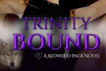Trinity Bound / Trinity Bound – Redwood Pack Book 3  A human is the only one left to save a werewolf and a witch. Will Josh be enough to save Reed and Hannah?