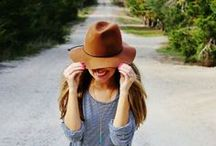 a hat might be......... classy,cute,stylish,chic,elegant,bohemian