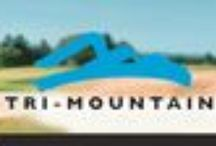 Tri-Mountain / Founded in 1993, Tri-Mountain® has gained recognition as a leading supplier of corporate identity apparel Since 2000.  Our five brands, Tri-Mountain®, Tri-Mountain Gold™, Tri-Mountain Performance®, Lilac Bloom® and TMR®, offer an unprecedented selection of knit and woven shirts, fleece and outerwear for the promotional, corporate casual, uniform, golf, performance, racing and sporting good markets. http://www.raisingtrend.com/tri-mountain.html