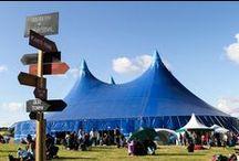 UTSf2015 Gallery / #musicfestival #familyfestival #camping #bigtop #music #folk #katerusby #brucemolsky #kestoncobblersclub #philipselway #marychapincarpenter #martinsimpson #riproaringsuccess #doritetrio #sitedecor #giantflowers #cloudnindecor #bluesky #flags #sunshine #circusskills #circus #juggling #electricswingcircus #flatvilleaces #cajun #swing #dance #streettheatre #performingarts #entertainment