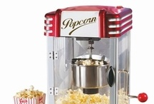 Popcorn Machines / In American Indian folklore, some tribes were said to believe that quiet, contented spirits lived inside of each popcorn kernel. When their houses were heated, the spirits would become angrier and angrier, shaking the kernels, and when the heat became unbearable, they would burst out of their homes and into the air in a disgruntled puff of steam.