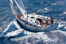 Forty feet of Maggie Mae / Maggie Mae, a 40 foot Bavaria Ocean yacht. Large rear cabin, lots of rich dark panelling, a galley to make a feast in.....