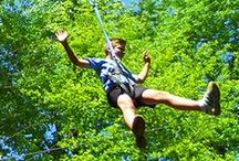 1000' Dual Zip Lines / The 1000' Dual Zip Lines are another one of Camelback Mountain Adventures' heart-pounding experiences. We'll harness you up and get you ready to zip through the trees at up to 8 stories above the ground! Our Dual Zip Lines are perfect for racing a family member or friend, so you can have bragging rights all the way home. There's nothing quite like the sound of a zip line in the Poconos - try it once, and you'll be back for more!