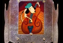 """Nightlights / Bella Luz Studio """"Luminette"""" nightlights.  The frames are copper, textured and treated with patina.  The images are translucent reproductions of origninal pastel and colored pencil drawings.  I sell them on my own website www.bellaluz.com and on Etsy at https://www.etsy.com/shop/BellaLuzStudio"""