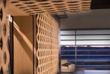 Sunscreen by Ferruccio Laviani / Nasce dalla collaborazione con il designer Ferruccio Laviani il rivestimento in rovere naturale intrecciato a profili in bronzo con frangisole integrato. The results of the collaboration between the designer Ferruccio Laviani and ISAM is the coating in natural oak woven with profiles in brass with integrated sunscreen.