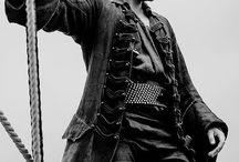 "bs | pirate king. / black sails | captain flint  | former member of the royal navy, now notorious pirate | in love with man and in war with england || ""everyone is a monster to someone. since you are so convinced that i am yours, i will be it."""