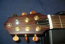 Yamaha Silent Guitar Repair / A couple of months ago I repaired 4 or 5 of these Yamaha Silent Acoustic Guitars. They all had pretty much the same problem. Bridge held on with two wimpy screws, and lifting off the guitar. Here are the pictures.