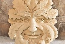 Greenman, Pan, Vertumnus & Woodwose / Greenman: pagan image that appeared in carvings & paintings across Europe for centuries ,a symbol of regeneration of the spirit & natural energy present in all growing plants. Associated with Pan, Celtic gods, Gaia, May Day & Robin Hood.  Branches or vines may sprout from the nose, mouth, nostrils or other parts of the face and these shoots may bear flowers or fruit. Pan will have horns. Woodwose is a wildman. Best greenman in NYC: South side E 95th St at front of Diller Quaille School.