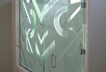 Glass Shower Doors / Glass Shower Doors with custom designed etched and carved sandblasted designs by Sans Soucie Art Glass of Palm Desert, California.  Glass is packed in-house and ships worldwide at reasonable price!