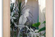 Etched Glass Doors / Glass Doors, both interior and entry, with custom designed etched and carved sandblasted designs by Sans Soucie Art Glass of Palm Desert, California.  Doors are packed in-house and ship worldwide at reasonable prices!  Sans Soucie has an incredible online Door Designer where you customize your wood type, size and glass design, with hundreds of designs to choose from in a wide range of price!