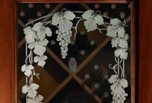 Wine Room Doors / Glass Wine Room, Wine Cellar Doors with custom designed etched and carved sandblasted designs by Sans Soucie Art Glass of Palm Desert, California.  Glass is packed in-house and ships worldwide at reasonable price!  Sans Soucie has an online Door Designer where you customize your wood type, door size, glass design!