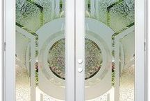 Glass Doors - same design done different. / Glass doors with etched and frosted designs by Sans Soucie will provide the privacy you need, thru beautiful works of art captured in glass.  All glass is hand sandblast etched and can be executed in a variety of ways, resulting in not only a different look, but a different price.   Using our beautiful Sun Odyssey design to demonstrate, all the doors below feature the same design, done in different sandblast or leaded glass effect.