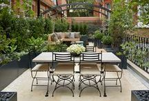 Project Aralia Rooftop Gardens  - Knightsbridge Terrace / Winner of Gold award for 'Best Roof Terrace Garden at the New Homes Garden Awards 2014. The roof terrace in Knightsbridge offers the user a sumptuous garden retreat, combining outdoor dining and luxury lounge area with beautiful features such as an extravagant fire pit, cascading water feature and structural archways and raised planters. Together these features heighten a sense of journey and experience in this small urban garden.