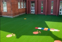 School Yards / We design and supply safe play surfaces for schools. Non slip, affordable, attractive synthetic grass. Unique colours/patterns and shapes.     Friction - Burn Free   Non - Slip      Non - Fade   Clean   Recycable  