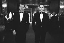 Suits / The hotshot lawyer in New York City; Harvey Specter (Gabriel Macht), hires a fraud with a photographic memory named Mike Ross (Patrick J. Adams).