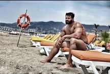 Bodybuilders At The Beach / Sea / Pool