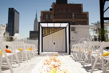 Modern Rooftop Wedding / Clean, modern rooftop wedding at Studio 450, decorated with white balloons, yellow and orange flowers contrasting with the beautiful black vases. The most unique details of this wedding were the heart shaped puzzles used as place settings and the puzzle pieces used as escort cards. A gorgeous wedding!