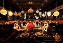 "Classic Art Deco Wedding / An elegant Gay wedding at Edison Ballroom NYC meticulously decorated with pink flowers, black tablecloths and gold accents. The gorgeous chandeliers forming an ""X"" along the tables gave this wedding a uniquely romantic touch."