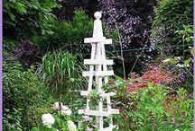 Garden tuteurs, trellises & obelisks / Vertical garden structures / by Diane V.