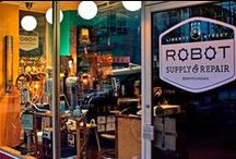 826michigan Liberty Street Robot Supply & Repair / Your worldwide supplier for Better Bot's Robot Repair Co., OHM, Food*, G-Wiz, Dr. Blotch's Latest Inventions, the Liberty Brand, and more! Serving the needs of robots, robot enthusiasts, and robot owners in the Midwest and beyond since 2008.
