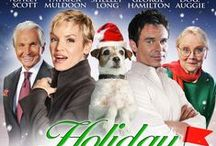 Holiday Road Trip (2013) / Two feuding pet shop employees fall for each other while escorting a celebrity dog on a Christmas promotional tour. Jerry Lacy, George Hamilton, Patrick Muldoon, Ashley Scott, Shelley Long, Cliff Emmich & Uggie, the dog.