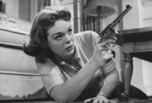 """{ Girl with the gun... } / """"Guns, she was reminded then, were not for girls. They were for boys. They were invented by boys. They were invented by boys who had never gotten over their disappointment that accompanying their own orgasm there wasn't a big boom sound."""""""