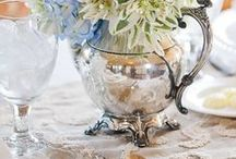 Vintage silverware / Vintage silver trays, goblets, teapots and vases.  Creates a romantic and whimsical feel to any event
