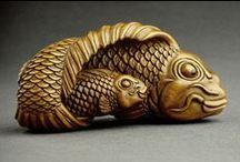 Hецке - Netsuke / Нэ́цкэ[1] (яп. 根付 netsuke, нэцукэ?) — миниатюрная скульптура, произведение японского декоративно-прикладного искусства, представляющее собой небольшой резной брелок.- Ne?cke[1] (yap. ?  netsuke, нэцукэ?)   tiny sculpture, product japanese decorative-aplied arts, presenting itself small carved key ring.