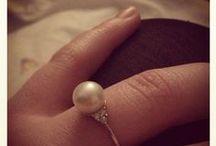 Pearl rings on fingers