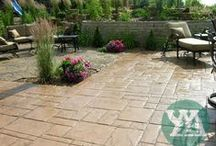 Patios / Adding a paver, natural stone, or decorative concrete patio to your home is a great way to enhance its value and create a relaxing hideaway to spend with family and friends. Check out some of our projects to see the amazing variety of colors, textures, and patterns available to complement your landscape.